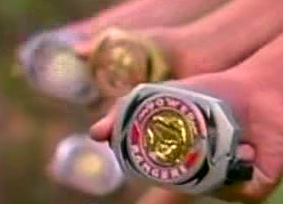 Background: White Ranger's gold Morpher